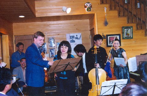 With members of the Nagoya Philharmonic Orchestra at the home concert in Tsukude, Japan, 1999